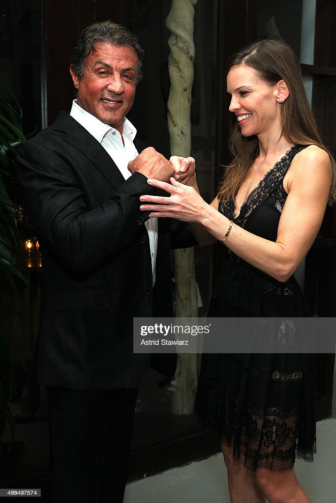 Sylvester Stallone and Hilary Swank attend DuJour Magazine's Jason Binn Celebrates Annual Art Basel Miami Beach Kick-Off Party at Delano Beach Club on December 1, 2015 in Miami Beach, Florida.