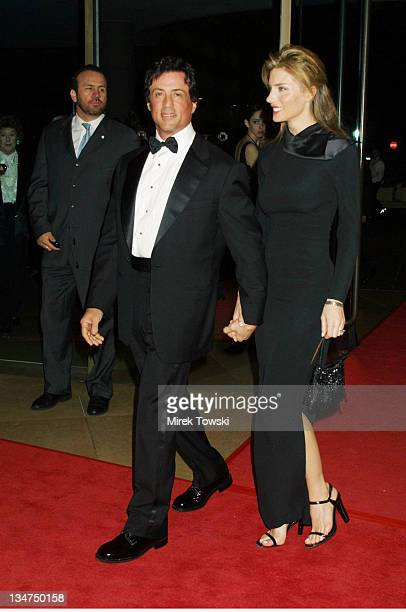 Sylvester Stallone and his wife Jennifer Flavin during American Film Institute Life Achievment Award Tribute at Beverly Hilton Hotel in Beverly Hills...