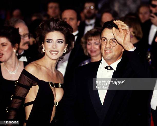 Sylvester Stallone and Jennifer Flavin arrive at the The 64th Academy Awards March 30 1992 at the Dorothy Chandler Pavilion Los Angeles California