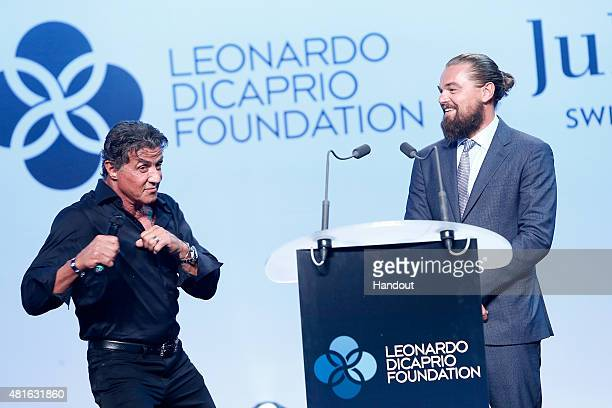 Sylvester Stallone and Leonardo DiCaprio speak onstage at a Dinner and Auction during The Leonardo DiCaprio Foundation 2nd Annual SaintTropez Gala at...