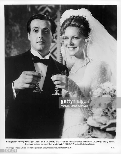 Sylvester Stallone and Melinda Dillon toast at wedding in a scene from the film 'FIST' 1978