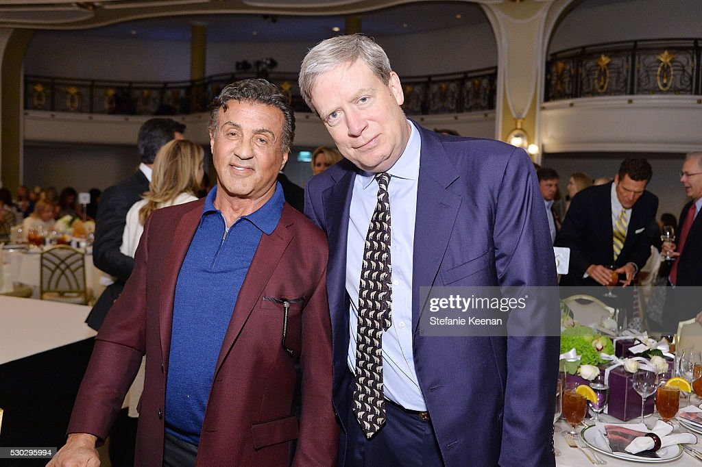 Sylvester Stallone (R) and Stanley Druckenmiller attend CHIPS Luncheon Featuring St. John at Beverly Hills Hotel on May 10, 2016 in Beverly Hills, California.