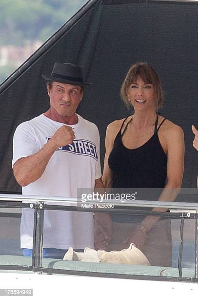 Sylvester Stallone and wife Jennifer Flavin are seen leaving the harbour of Saint Tropez on August 4 2013 in SaintTropez France
