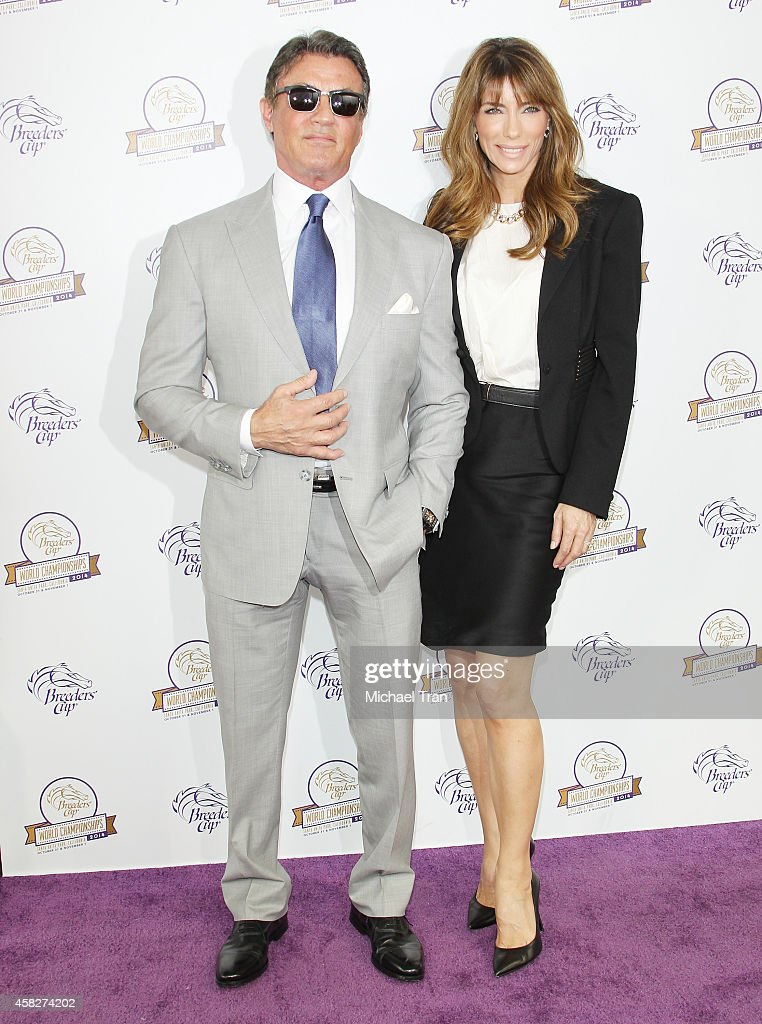 Sylvester Stallone (L) and wife Jennifer Flavin arrive at the 2014 Breeders' Cup World Championships held at Santa Anita Park on November 1, 2014 in Arcadia, California.
