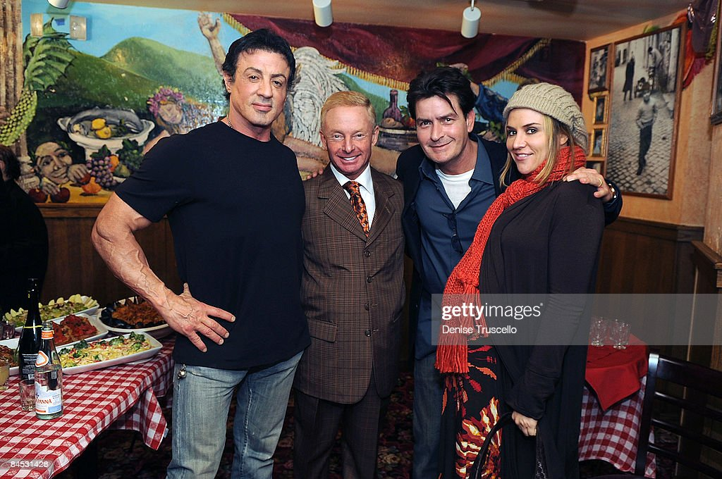 Sylvester Stallone, Elliot Mintz, Charlie Sheen and his wife Brooke Mueller celebrate the opening of Buca di Beppo restaurant on January 28, 2009 in Universal City, California.