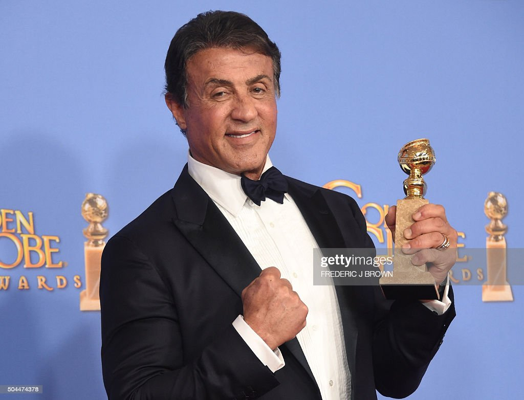 TOPSHOT - Sylvester Stallone poses in the press room with his award for Best Supporting Actor In A Motion Picture, at the 73nd annual Golden Globe Awards, January 10, 2016, at the Beverly Hilton Hotel in Beverly Hills, California.
