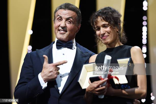 Sylvester Stallone presents Mati Diop with the Grand Prix award for her film Atlantique at the Closing Ceremony during the 72nd annual Cannes Film...