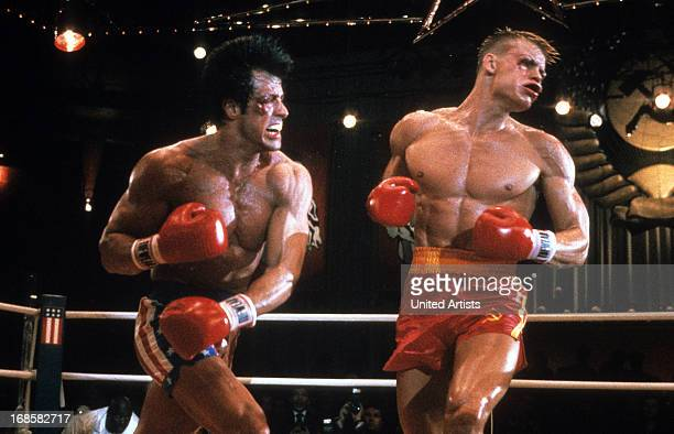 Sylvester Stallone punches Dolph Lundgren in a scene from the film 'Rocky IV' 1985