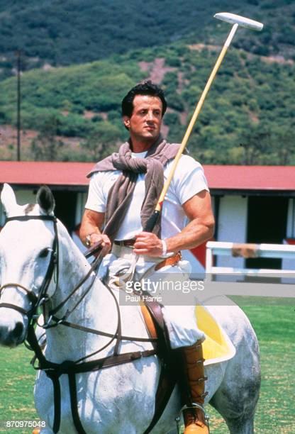 Sylvester Stallone rides a horse and prepares to play Polo at the Santa Barbara Polo Club July 10 1989 Santa Barbara Polo Club Santa Barbara...