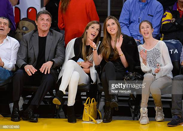 Sylvester Stallone Sistine Rose Sophia Rose Stallone and Scarlet Rose Stallone attend a basketball game between the New Orleans Pelicans and the Los...