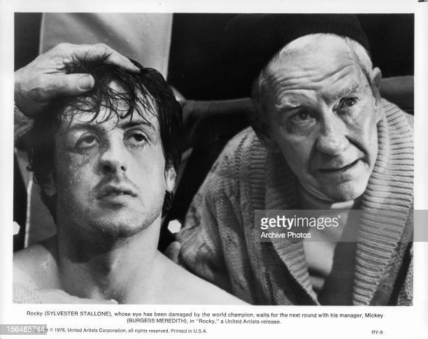 Sylvester Stallone waits for the next round with Burgess Meredith in a scene from the film 'Rocky' 1976