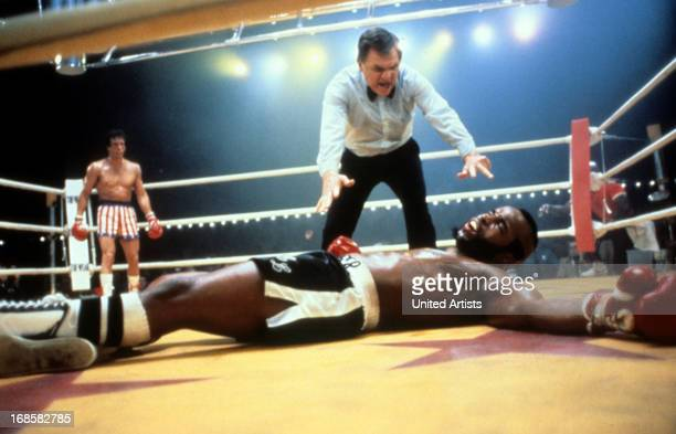 Sylvester Stallone watches as Carl Weathers falls in a scene from the film 'Rocky III' 1982