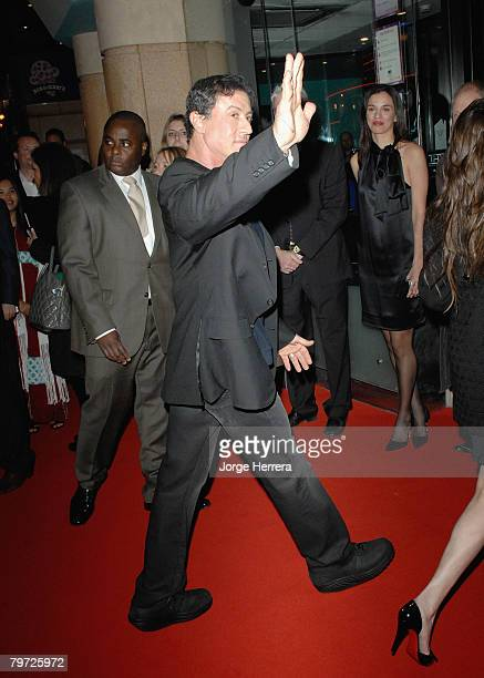 Sylvester Stallone waves to the fans as he arrives at the London Gala Premiere of Rambo at the Vue West End on February 12 2008 in London England