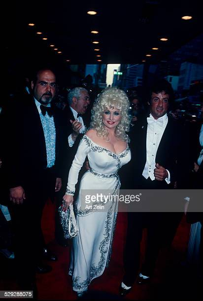 Sylvester Stallone with Dolly Parton at a formal event circa 1970 New York