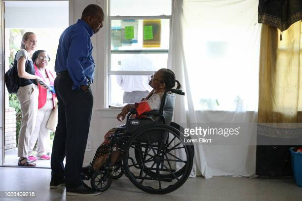Sylvester Turner mayor of the city of Houston meets with local resident Dorothy Rainey in the Kashmere Gardens neighborhood on August 25 2018 in...