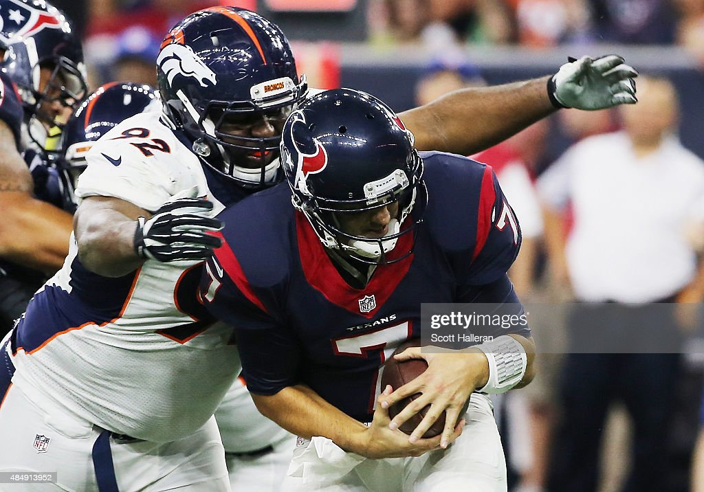 Sylvester Williams #92 of the Denver Broncos sacks Brian Hoyer #7 of the Houston Texans in the first half of their game at NRG Stadium on August 22, 2015 in Houston, Texas.