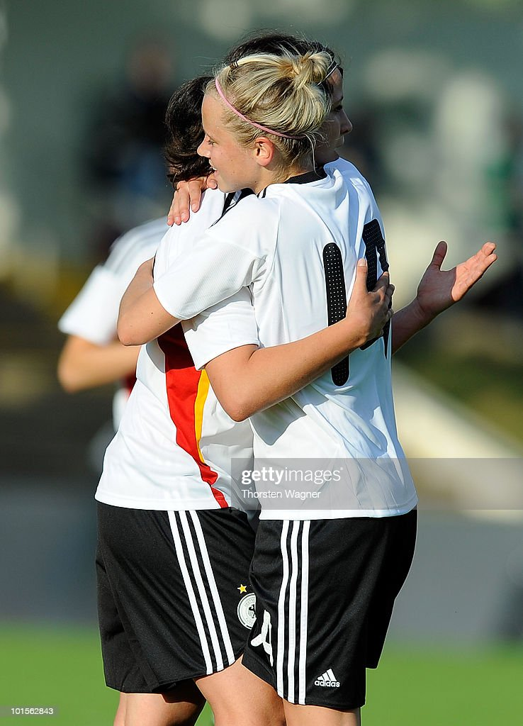 Sylvia Arnold (L) celebrates after scoring the 3:0 with her team mate Laura Brosius (R) during the U20 international friendly match between Germany and South Korea at Waldstadion on June 2, 2010 in Giessen, Germany.