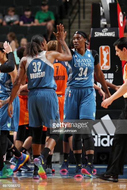 Sylvia Fowles and Rebekkah Brunson of the Minnesota Lynx high five each other during the game against the Connecticut Sun during a WNBA game on June...