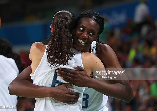 Sylvia Fowles and Sue Bird of United States celebrate after winning the Women's Gold Medal Game between United States and Spain on Day 15 of the Rio...