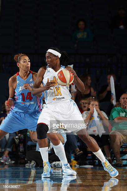 Sylvia Fowles of the Chicago Sky drives on Erika de Souza of the Atlanta Dream on August 17 2012 at the Allstate Arena in Rosemont Illinois NOTE TO...