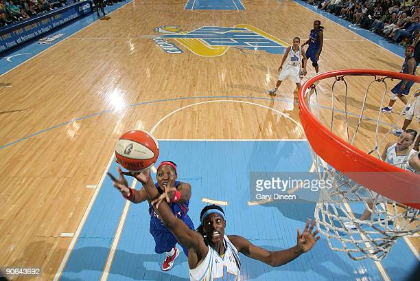 Sylvia Fowles of the Chicago Sky grabs for the rebound against Cheryl Ford of the Detroit Shock during the WNBA game on September 12 2009 at the UIC...