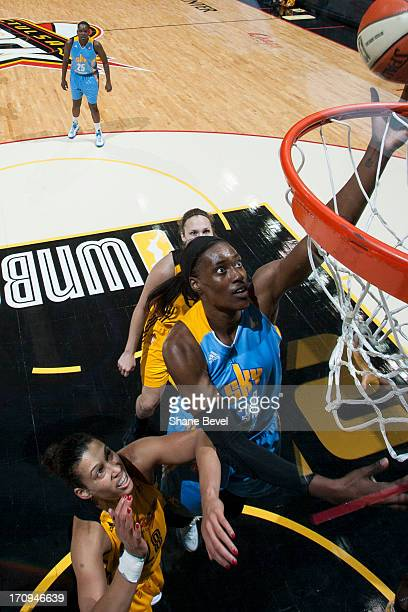 Sylvia Fowles of the Chicago Sky shoots against Nicole Powell of the Tulsa Shock during the WNBA game on June 20 2013 at the BOK Center in Tulsa...
