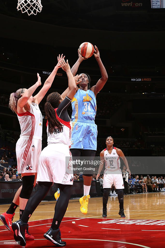 Sylvia Fowles #34 of the Chicago Sky shoots against Stefanie Dolson #31 and Tierra Ruffin-Pratt #14 of the Washington Mystics at the Verizon Center on August 13, 2014 in Washington, DC.