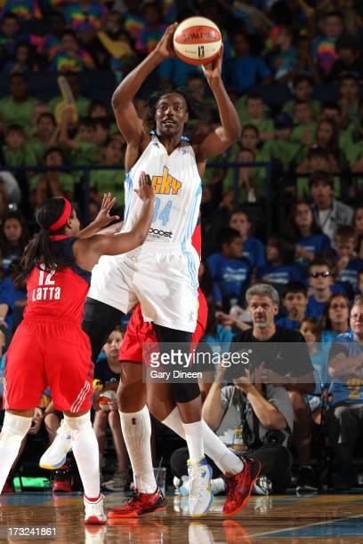 Sylvia Fowles of the Chicago Sky throws a pass over Ivory Latta of the Washington Mystics during the game on July 10 2013 at the Allstate Arena in...