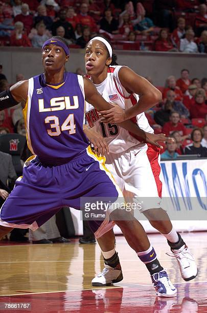 Sylvia Fowles of the LSU Tigers boxes out for position against Laura Harper of the Maryland Terrapins at the Comcast Center on November 18 2007 in...