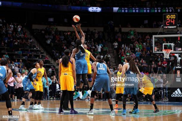 Sylvia Fowles of the Minnesota Lynx goes for the tip off against Nneka Ogwumike of the Los Angeles Sparks during a WNBA game on August 11 2017 at...