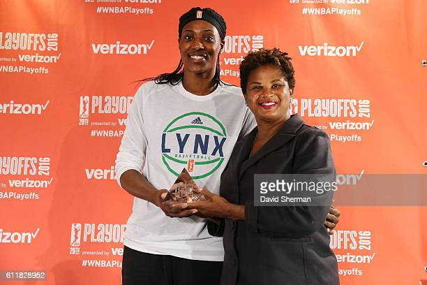 Sylvia Fowles of the Minnesota Lynx receives the 2016 WNBA Defensive Player of the Year Award from WNBA Chief of Basketball Operations/Player...