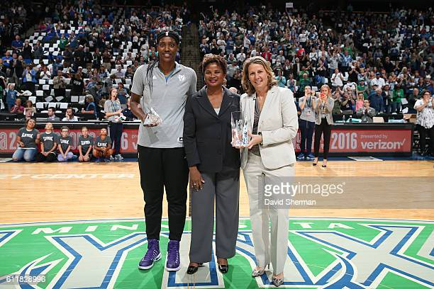 Sylvia Fowles of the Minnesota Lynx receives the 2016 WNBA Defensive Player of the Year Award and Head coach Cheryl Reeve of the Minnesota Lynx...