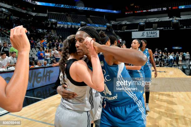 Sylvia Fowles of the Minnesota Lynx shares a hug with Kelsey Plum of the San Antonio Stars after the game during a WNBA game on August 25 2017 at the...