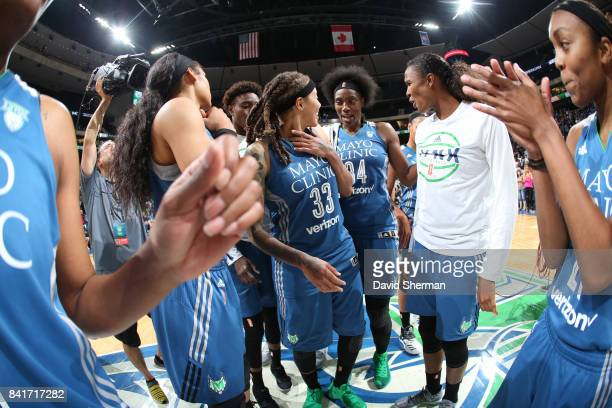 Sylvia Fowles of the Minnesota Lynx with teammates celebrate a win against the Chicago Sky on September 1 2017 at Xcel Energy Center in St Paul...