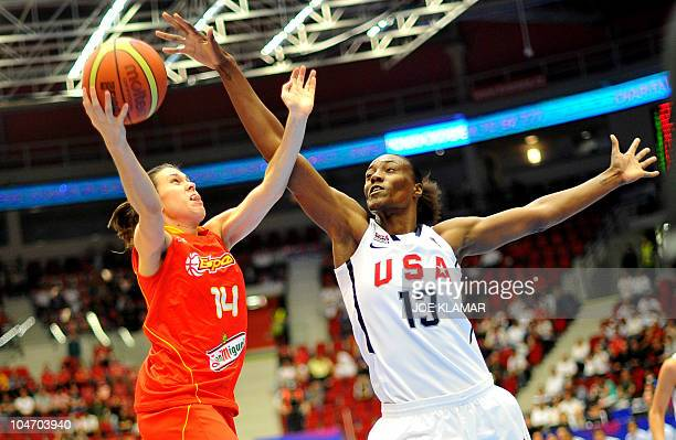 Sylvia Fowles of the US blocks Spain's Anna Cruz Lebrato during the semifinal match between the US and Spain during the Women's FIBA World...