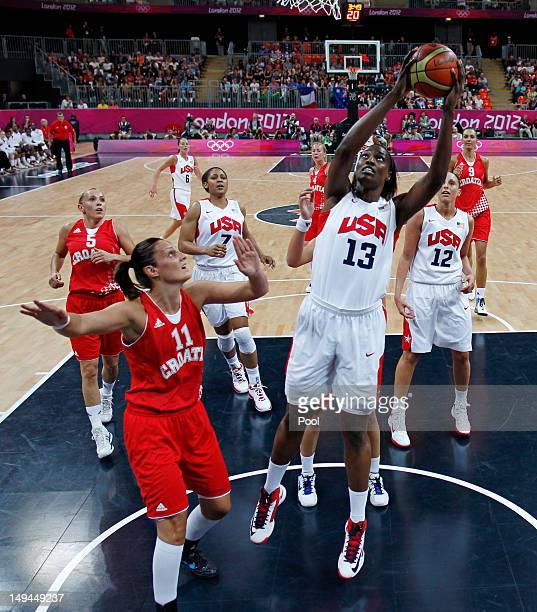 Sylvia Fowles of the US grabs a rebound over Croatia's Ana Lelas during the women's Group A basketball match on Day 1 of the London 2012 Olympic...
