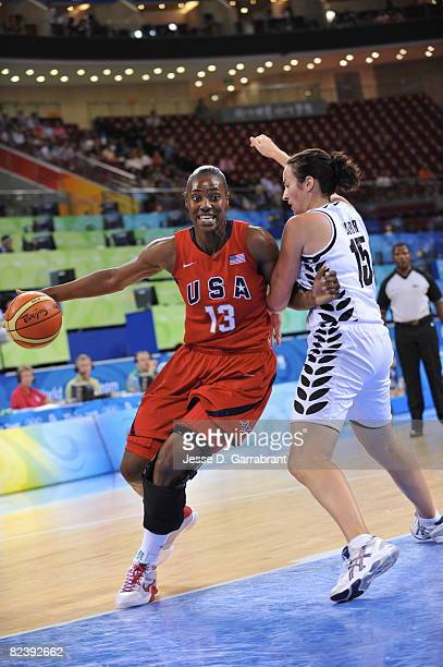 Sylvia Fowles of the U.S. Women's Senior National Team drives against Aneka Kerr of New Zealand during the women's preliminary round group B...