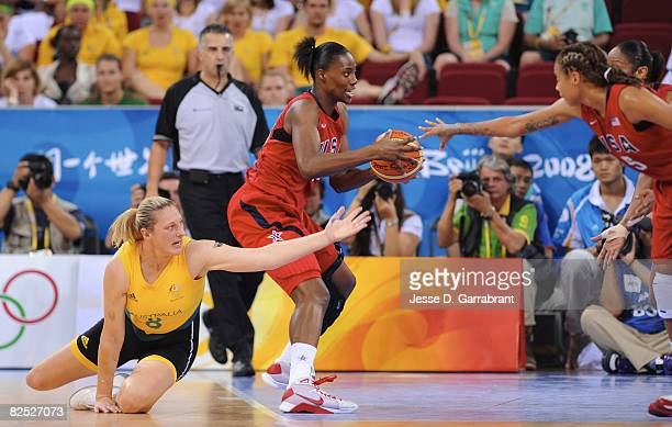 Sylvia Fowles of the US Women's Senior National Team gets the ball against Suzy Batkovic of Australia during the women's gold medal basketball game...