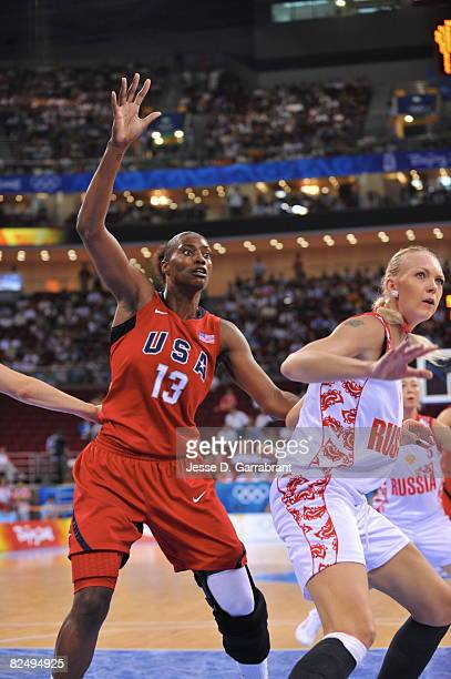 Sylvia Fowles of the U.S. Women's Senior National Team looks for the ball against Russia during the women's semifinals basketball game at the 2008...