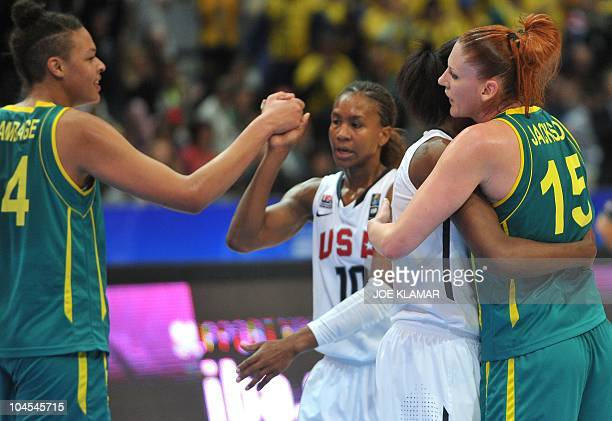 Sylvia Fowles of the USA is hugged while congratulated by Australia's captain Lauren Jackson during the match between the USA and Australia during...
