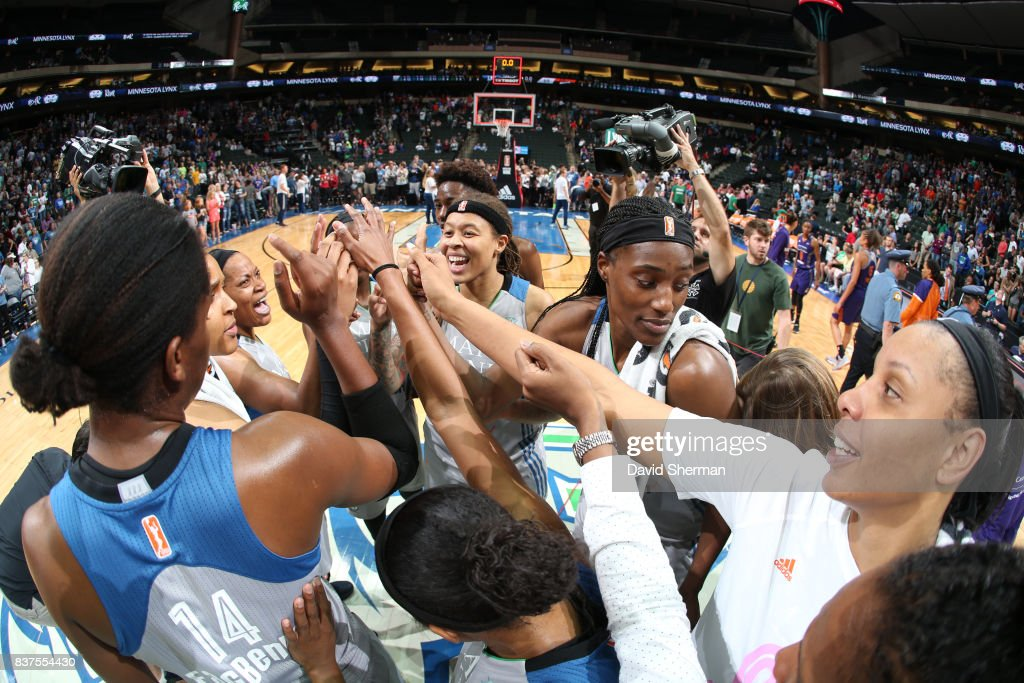 Sylvia Fowles #34, Seimone Augustus #33 of the Minnesota Lynx with teammates celebrate a win against the Phoenix Mercury on August 22, 2017 at Xcel Energy Center in St. Paul, Minnesota.