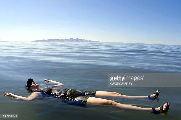 Sylvia Frost from Phoenix Arizona floats on the Great Salt LakeUtah 24 July 2001 The Great Salt Lake is five to eight times saltier than the ocean...