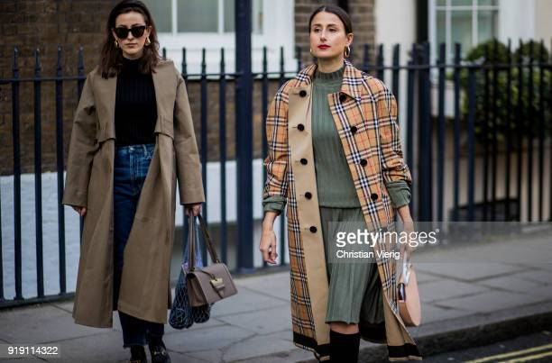 Sylvia Haghjoo and Julia Haghjoo wearing plaid Burberry coat seen outside Mulberry during London Fashion Week February 2018 on February 16 2018 in...