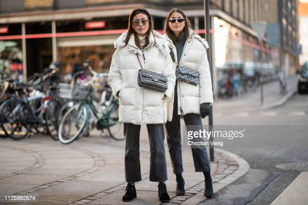 Sylvia Haghjoo and Julia Haghjoo wearing white jacket Chanel bag Dior bag cropped denim jeans is seen outside Mykke Hofmann during the Copenhagen...