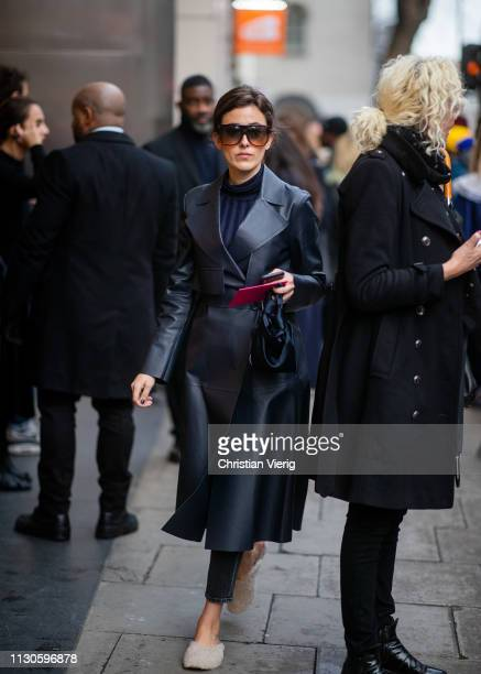 Sylvia Haghjoo is seen wearing navy coat outside Christopher Kane during London Fashion Week February 2019 on February 18 2019 in London England