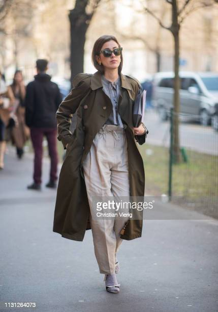 Sylvia Haghjoo is seen wearing olive trench coat high waist pants outside Fendi on Day 2 Milan Fashion Week Autumn/Winter 2019/20 on February 21 2019...