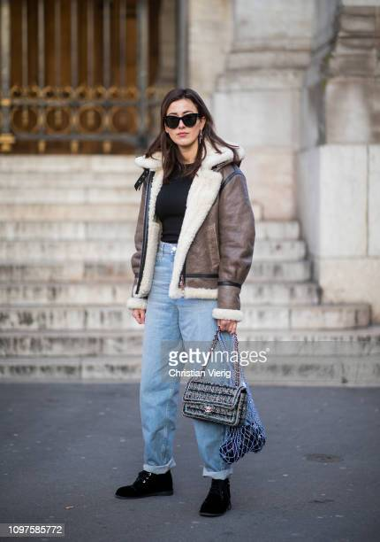 Sylvia Haghjoo is seen wearing shearling jacket, denim jeans outside Schiaparelli during Paris Fashion Week - Haute Couture Spring Summer 2019 on...