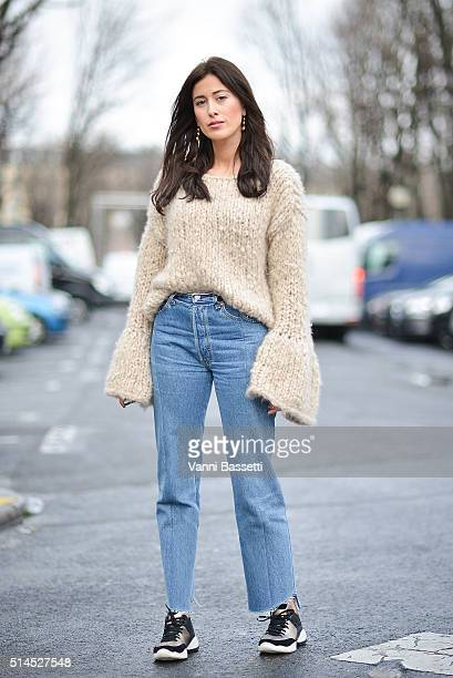 Sylvia Haghjoo poses wearing Vetements pants and Geox shoes before the Moncler Gamme Rouge show at the Grand Palais during Paris Fashion Week FW...
