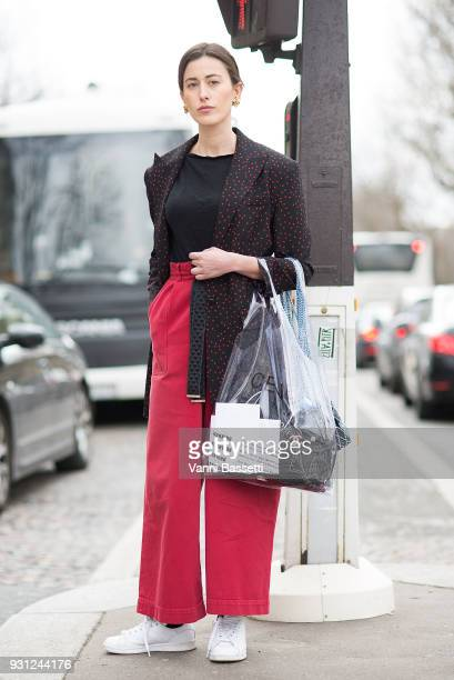 Sylvia Haghjoo poses with a Celine plastic bag after the Miu Miu show at the Palais de Iena during Paris Fashion Week Womenswear FW 18/19 on March 6...