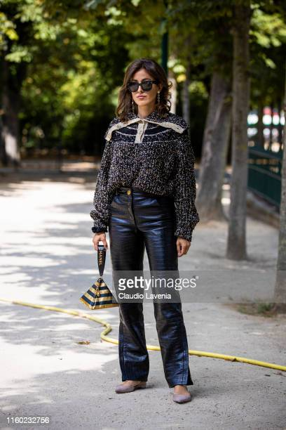 Sylvia Haghjoo, wearing a beige and black decorated sweater, black leather trousers, taupe shoes and gold and black Chanel bag, is seen outside...